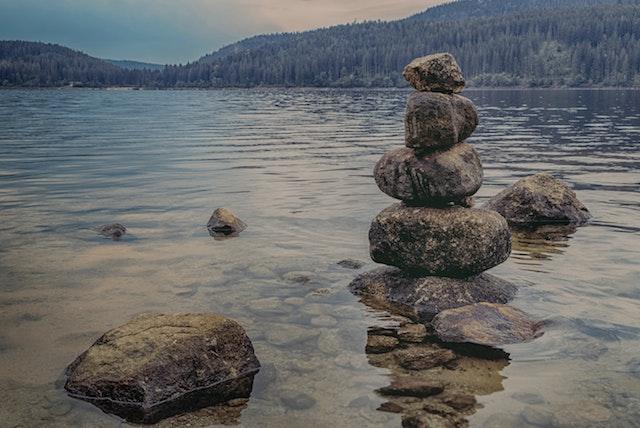 balancing stones by a lake