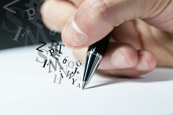 letters floating from a pen onto paper