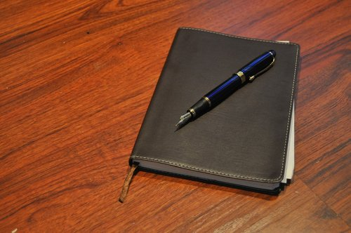 a journal and fountain pen