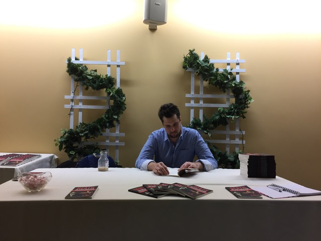 Author Loren Mayshark at a book signing for Death: An Exploration